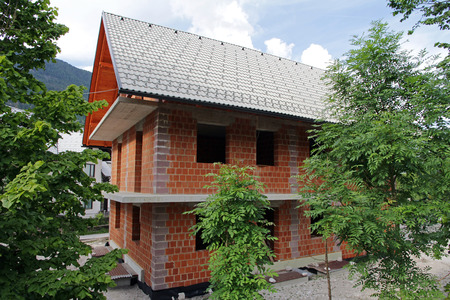The construction of a house. Newly Built Brick house Stock Photo