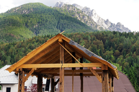 The shell of a wooden garage in the mountains. Newly Built Garage Wooden Stock Photo