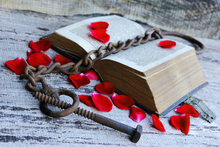 A captivating old love story of 1763. An ancient book with rose petals and chain