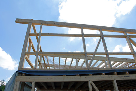 rafters: The construction of a wooden house. Carcass of a wooden house