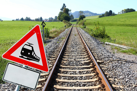 The German train. Railway sign and railway tracks