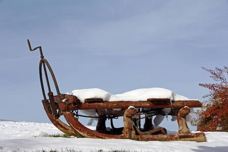 An old horse sledge in winter. Old transport sledge in the snow