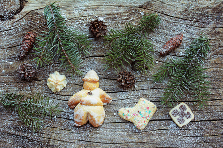 biscuit dough: A Santa Claus and biscuit dough from. Christmas decoration on wooden background