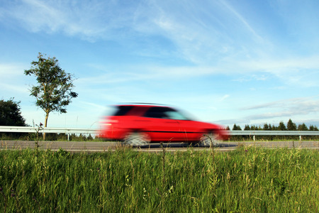 Lawn on German roads. Too fast driving by car on the road. Too fast driving on the road