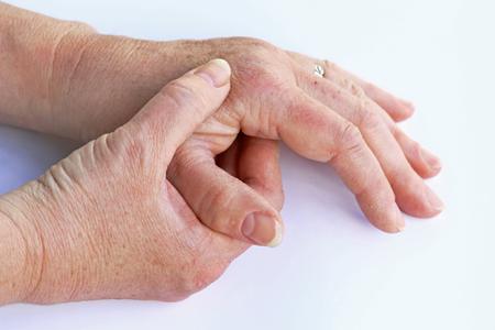 An elderly woman has pain in her hands