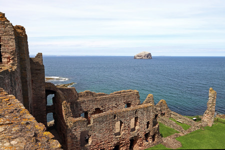 The castle ruins of Tantallon Castle with the island of Bass Rock in Scotland