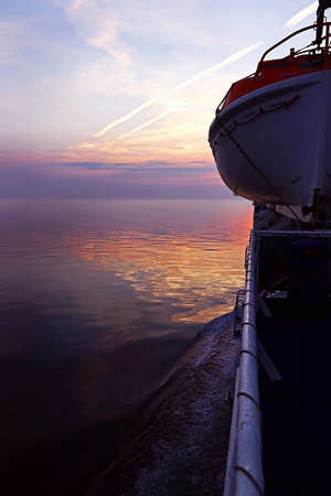 Lifeboat on a ship in the sundown. Lifeboat on a passenger liner