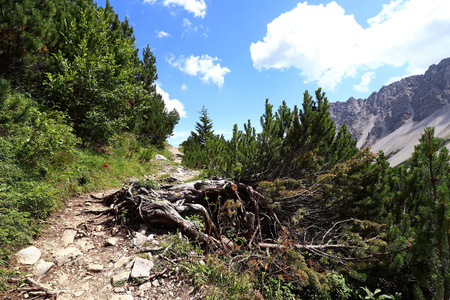 Mountaineering at Hahntennjoch in Austria. Mountain path in the mountains Stock Photo