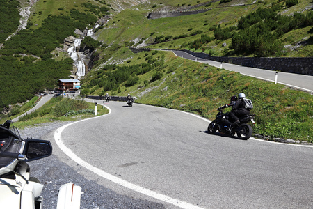 quickness: Motorcycling in the mountains. Motorsport on a mountain pass