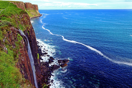Waterfall on the coast of Skye Island in the Scottish Highlands. Kilt Rock and Mealt Falls