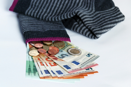 Hiding money in socks is an insecure investment. Hiding money in socks Stock Photo