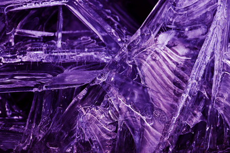 Close-up of frozen water in ultra violet. Abstract ice on a lake