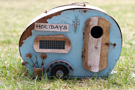 Holidays with the caravan. Symbolic of an old broken trailer. Dangerous journey on holiday Stock Photo