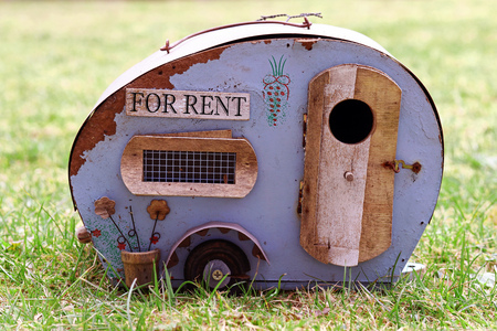Housing for rent. Holidays with the caravan. Symbolic for an old broken caravan and a bad accommodation