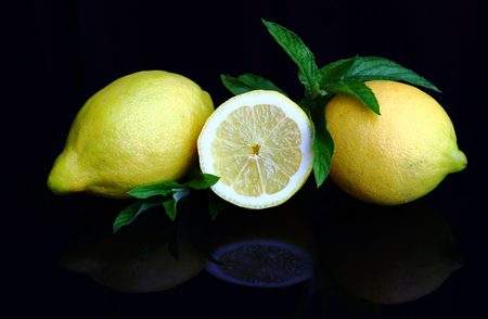 Fresh juicy lemons with peppermint. Sour is tasty and healthy Stock fotó