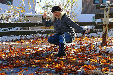 A woman slipped on wet leaves and fur. Wet leaves are dangerous