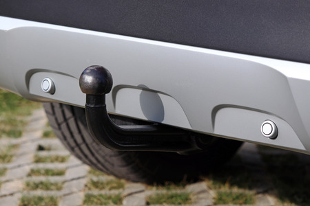 Trailer coupling on a silver-colored car with reverse warning devices Reklamní fotografie