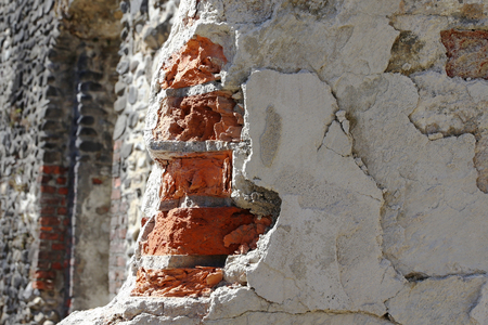 A broken, broken corner on a house wall.