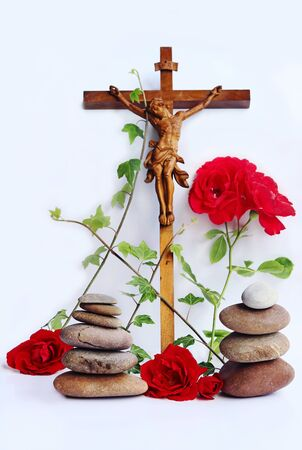 A Christian cross with red roses, ivy and stone towers 스톡 콘텐츠