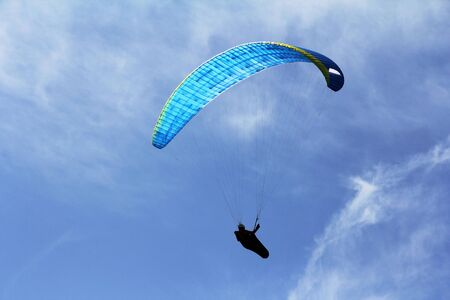 A paraglider flies towards the sky. Extreme sport in the air 스톡 콘텐츠