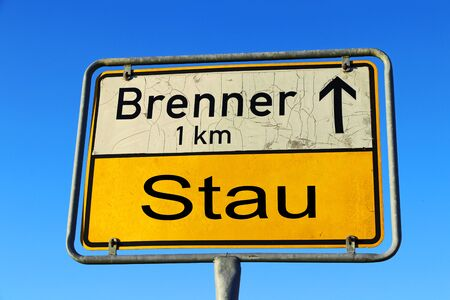Sign with traffic jam at Brenner Austria Italy