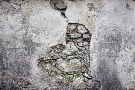 A dilapidated masonry. A broken wall on a building. Фото со стока - 134269845