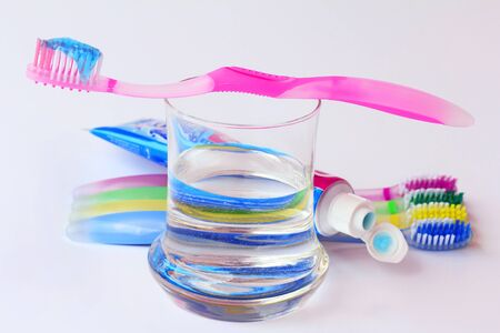 Healthy, well-kept teeth by brushing with toothbrushes and toothpaste