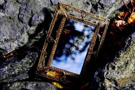 A golden enchanted mirror. A mirror for dreams and desires. Фото со стока - 135613880
