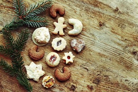 Delicious Christmas cookies on a wooden background Фото со стока