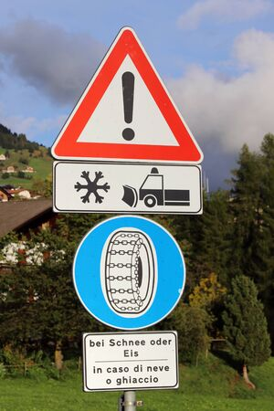 Traffic sign Attention snow plow and snow chains in case of snow
