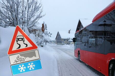 Attention danger of slipping in winter on snow-covered roads Фото со стока