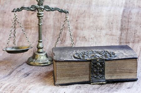 An old scale and an old book as a symbol for just legislation