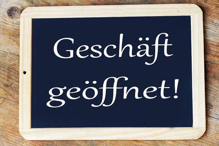 On a blackboard is written in German: Shop open!