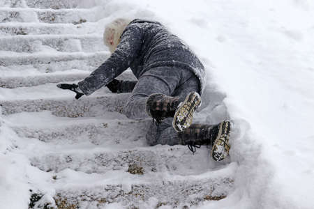 A woman slipped on the snow-covered stairs and fell