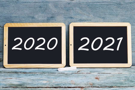Two boards with the written years 2020 and 2021
