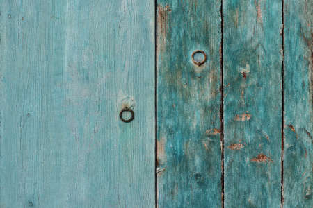 Wooden background of two different shutters of green-blue wood Standard-Bild