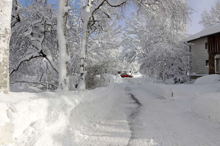On a street in a small town in Bavaria is a lot of snow in winter Standard-Bild