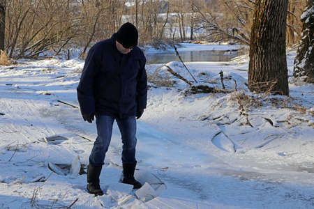 A man broke into the ice in winter. Dangerous thin ice