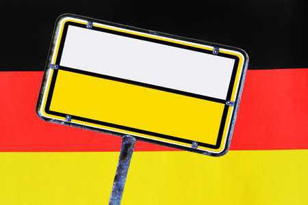 An empty yellow German street sign in front of Germany flag Standard-Bild