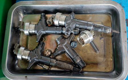 injector: Used old injector in garage Stock Photo