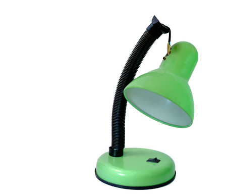 tumble down: old broken green table lamp nand on bulk in isolated Stock Photo