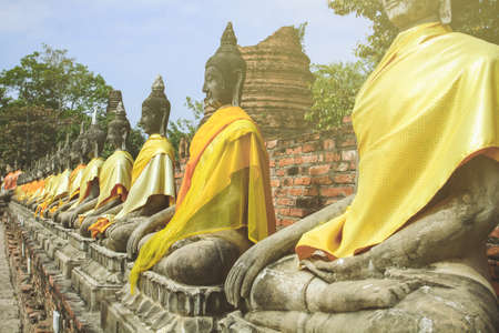 Contra light Sitting Buddhas alley in ancient city of Ayutthaya Thailand Stock Photo
