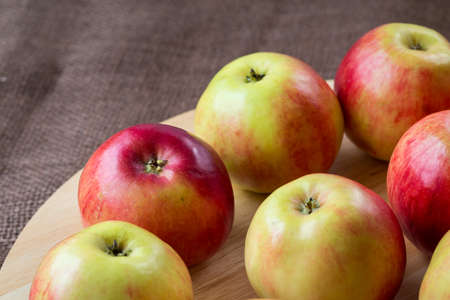 Red apples on wooden background, natural food.