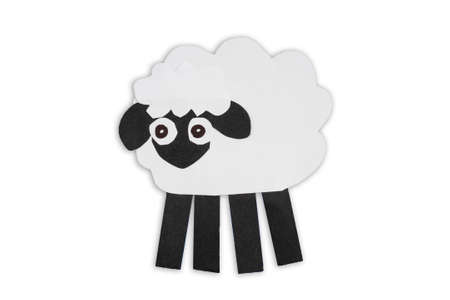 White sheep cut out of paper isolated on white background. Animals caricature for kids.