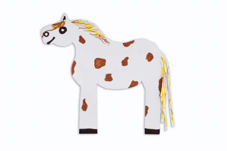 Mottled horse caricature cut out of paper isolated on white background. Animals caricature for kids. Фото со стока