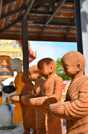 Small monk statue Stock Photo