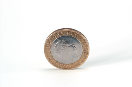 Two pounds coin against white background