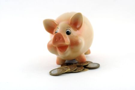 Money box in form of laughing orange piglet with few coins upfront