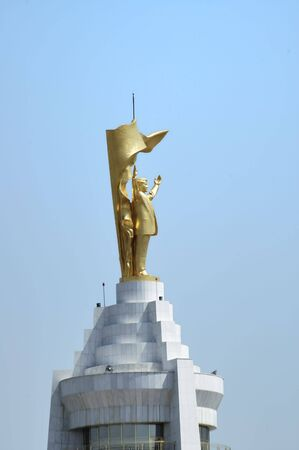 Golden statue on the top of Neutrality Arch
