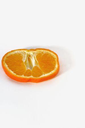 citrus reticulata: Mandarin (Citrus reticulata) slice against white background
